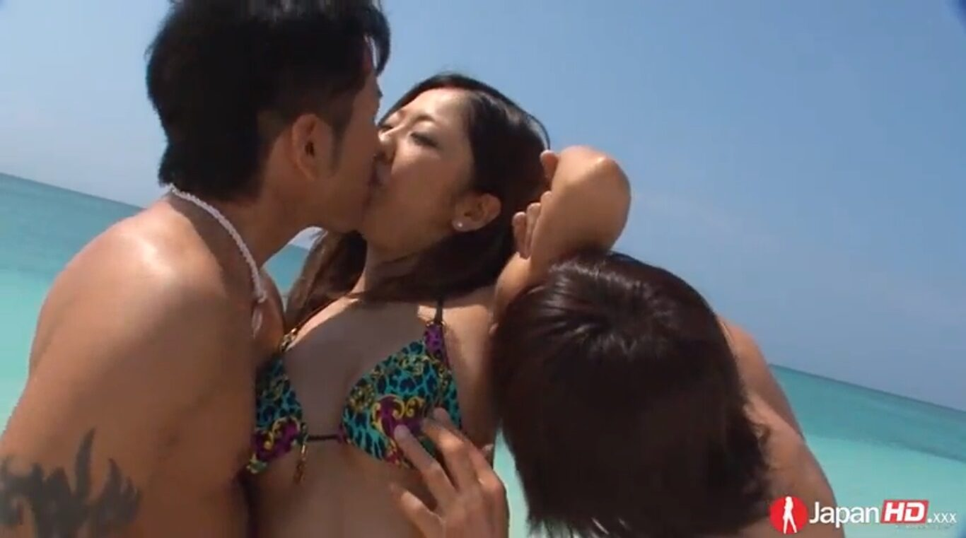 Two males from Japan decided to go even further in this threesome on the beach